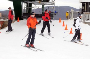 Photos By Paul Purpura ©2008 NCL : Skiers hop off of a lift at Wintergreen for a soft opening on Friday.