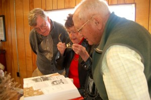 Earl along with his real life sister, Audrey and Paul Saunders look at a picture of Audrey she discovered in Paul's book, Heartbeats of Nelson.