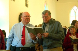 Rev. Tom Fowler and Earl sing from a hymnal at Saturday morning's special service in Schuyler.