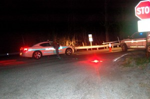 An Augusta County Deputy talks with a Nelson Officer at the intersection of Route 664 and the BRP at Reeds Gap Monday night.