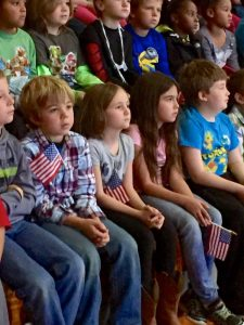 ©™2016 Blue Ridge Life Magazine / Nelson County Life Magazine : Photos By Hayley Osborne - Nelson Region Photographer : Sawyer Jackson of Greenfield  (2nd from left) is flanked by fellow classmates holding U.S. flags at Rockfish River Elementary School as part of their annual Veteran's Day celebration held Friday 11-11-16.