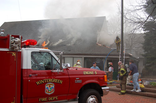 Wintergreen Fireman on roof with flames