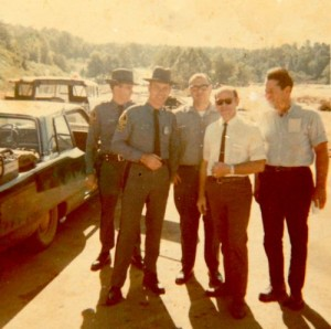 Dr. Raynor stops for a picture with state troopers and workers just after Hurricane Camille.