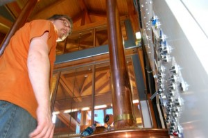Brewmaster, Jason Oliver, Of Devils Backbone Brewing in Beech Grove checks gauges in the brew house.
