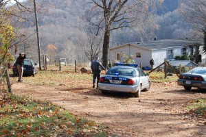 Law enforcement officers surround a home while in pursuit of fugitive, Lee Spencer.