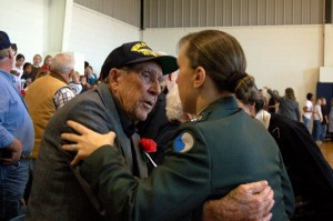 A WWII Veteran takes the opportunity to embrace a fellow service member in today's military.