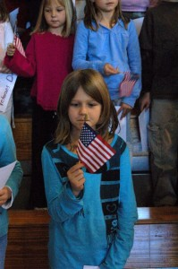 A RRES student studies the flag as the ceremony starts.