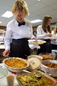 One of the concert band students fuels up on some very tasty food just before the performance of Christmas music.
