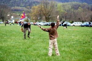 Photo By Yvette Stafford : ©2009 NCL Magazine : Richard Averitt of Nellysford, ducks as son Quinn launches his kite into the sky at Saturday's Rockfish Valley Kite Festival. Click on any image for larger view.