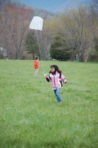 By Yvette Stafford : Another young girl runs as fast as she can to get her kite into the air.