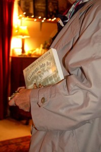 A fan stands in line clutching a book for an autograph Thursday night at The Hamner Theater.