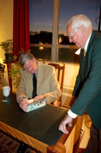 Earl autographs a book for a fan at Thursday night's reception.