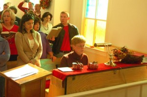 Jon Walmsley plays the piano at Saturday's event in Schuyler. His wife Marion is to his left.
