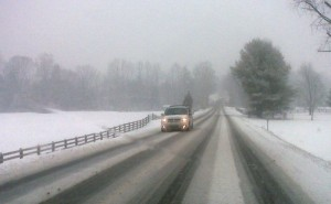Photo By Tommy Stafford : ©2010 www.nelsoncountylife.com : A driver cruises down a nearly deserted Route 151 just south of Nellysford, Virginia early Friday morning.