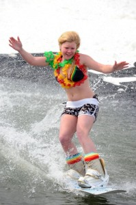 A young woman takes a skim across the 70' pond this past weekend at Wintergreen.