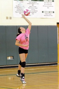 Madison Carver (7) (Middle Blocker) prepares to serve.