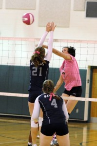 Photos By Paul Purpura : ©2010 www.nelsoncountylife.com :Madison Carter (7) (Middle Hitter) attacks in play Tuesday afternoon against Appomattox. Click on any image to enlarge.