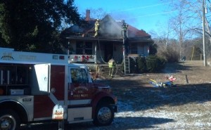 ©2014 Blue Ridge Life : Fire Crews work to extinguish what remains of a house fire that happened shortly after 8AM Friday morning - January 24, 2013 in Roseland just north of the post office on Route 151.