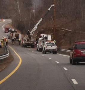 ©™2014 Blue Ridge Life : Photos Via Sgt Jerry Utz - Albemarle County Police : Utility Crews work to put a new pole in place early Wednesday morning - February 26, 2014 along Route 29 S near Covesville after a semi truck flipped, went up an embankment and clipped the pole.