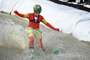 In full dress, a pond skimmer skis across the water at Wintergreen Resort this past Saturday - March 22, 2014.