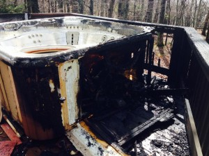 """This is all that remained of the hot tub and the surrounding deck after after the lightning strike. According to Chief Sheets, """"It looks like it struck the ground about 10 feet from the tub and then plowed a ditch to the deck."""""""