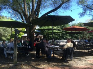 While it was a cool 59° for the high on Friday on the mountain, it was a much warmer 74° in the rockfish Valley down below. Jamie Tremel, a waitress at Wild Wolf Brewing in Nellysford waits on some of the people enjoying a beautiful fall afternoon.