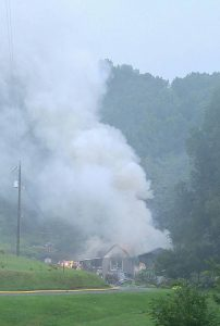 Photo by Monica Bautista : This home on Brogan Hollow Road just off Rout 6 River Road in Nelson County is described as a total loss after it's believed a lightning strike set it on fire late Wednesday afternoon - July 13, 2016.