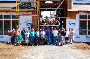 Juky 2008. The construction crew of Devils Backbone Brewing poses in front of the shell of the building before completion.