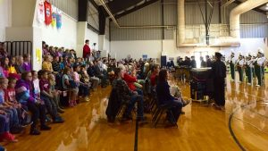Veteran's from various branches of service listen as the Nelson County High Marching Band plays during a ceremony held this past Friday - November 11, 2016 in the gymnasium at Rockfish River Elementary School in Afton.