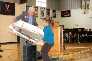 ©™ 2007-2016 Nelson County Life Magazine / Blue Ridge Life Magazine : Photo By Tommy Stafford : Back in November 2007 featured speaker, Captain Jack McNish, (now deceased) Retired U.S. Navy, hands a picture of a submarine to one of the students to show to the audience. McNish told about his time as a commander of the submarine during his time in the Navy.