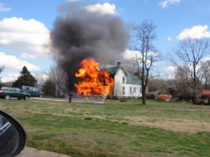 Photo courtesy of Linda Mawyer : Fire crews are on the scene of this fully involved house fire just off 151 in Greenfield / Afton near Paulie's Pig Out - March 3, 2017